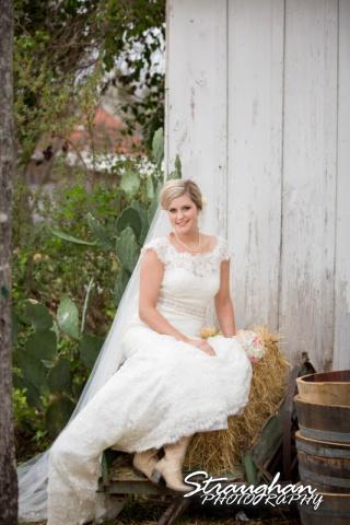 Emily's Bridal in Gruene sitting in wagon
