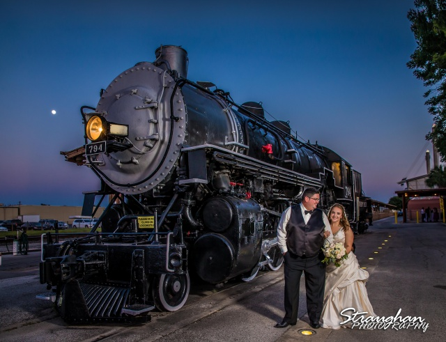 Elizabeth and Gregory's wedding Sunset Station picture in front of train looking at one another