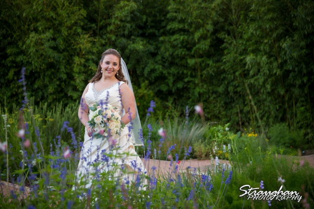 E Murray Bridal sitting Landa Library in the flowers