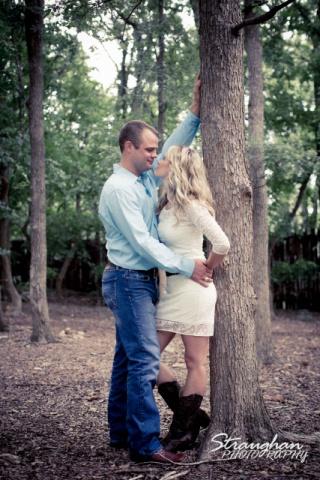 Lynn-Nathan's engagement Gruene, leaning on tree