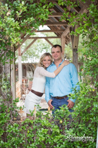 Lynn-Nathan's engagement Gruene, TX. inside gazebo with plants