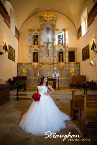 Erika Bridal portrait Mission San Jose in the church