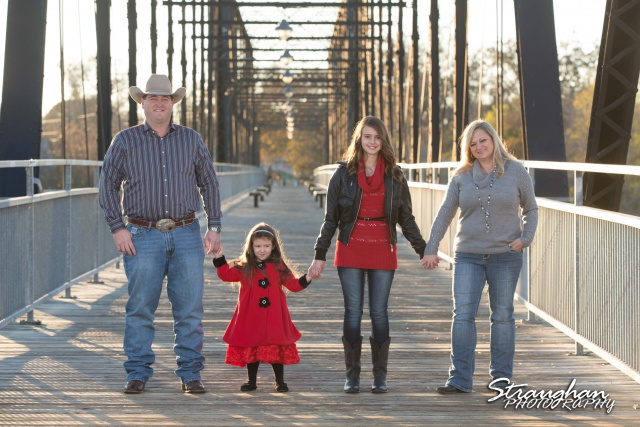 Mayes family portraits Faust street Bridge holding hands