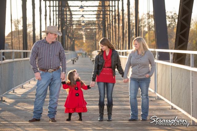 Mayes family portraits faust street Bridge looking at the girls