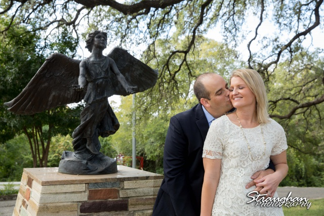 Gretchen Engagement UIW campus hugging by statue