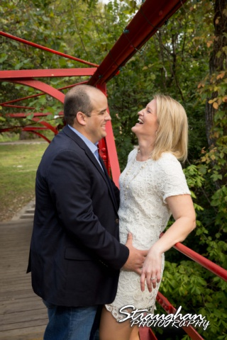 Gretchen Engagement UIW campus laughing on bridge