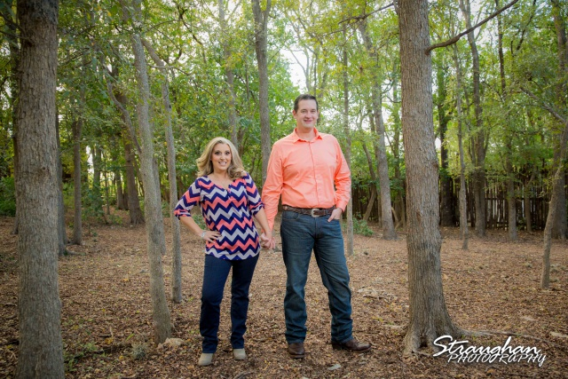 Heather engagement Gruene standing in trees