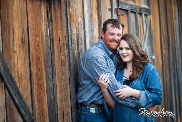 Heather and Wes's engagement session Gruene red wood wall