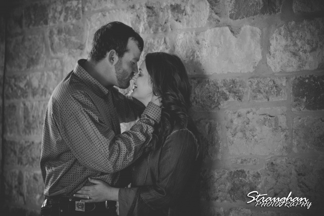 Heather and Wes's engagement session Gruene on the stone wall