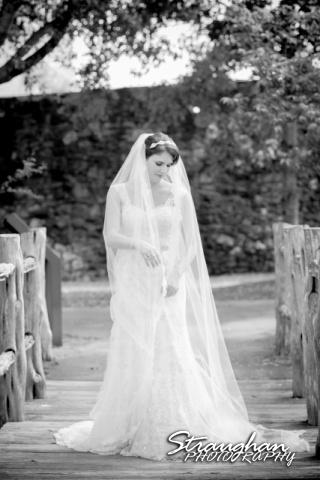 Jackie's Bridal Mission San Jose on the bridge with veil