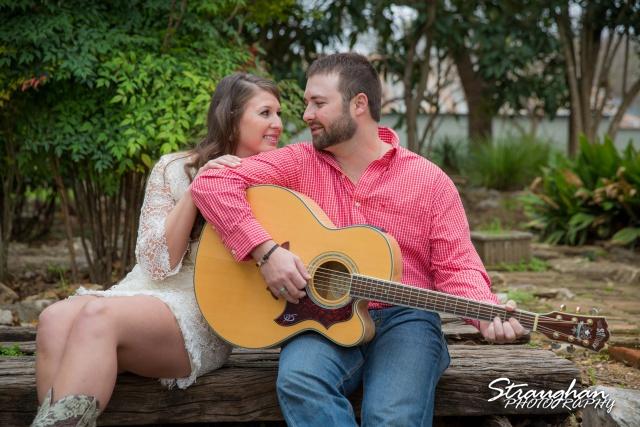Blais and Jessica engagement Gruene blais playing the guitar