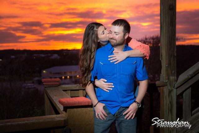 Blais and Jessica engagement Gruene Cheek kissing at sunset