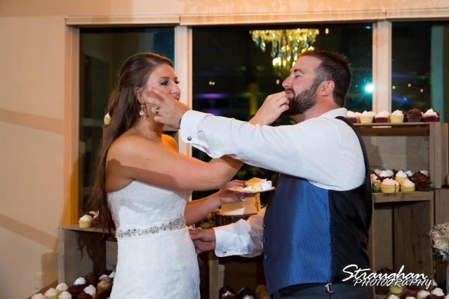 Blais_Jessica wedding the Lodge at Bridal Veil Falls cake feeding