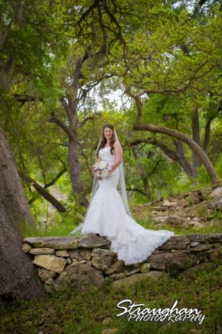Jess Birdy Bridal the Lodge at Bridal Veil Falls on top of rock