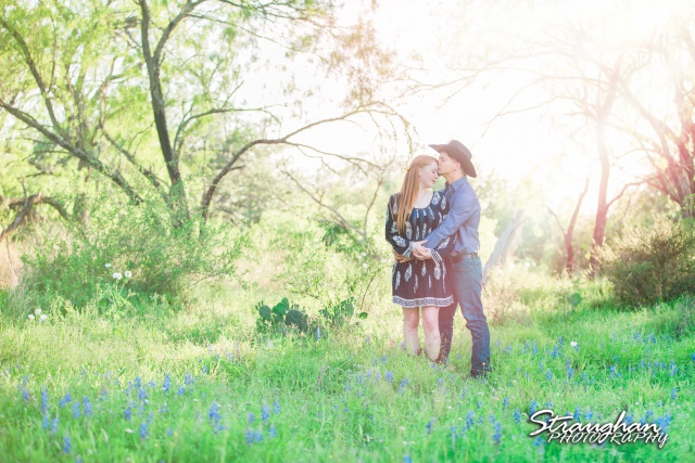 Caleb and Jamie's Engagement Poteet in the sunlight with bluebonnets