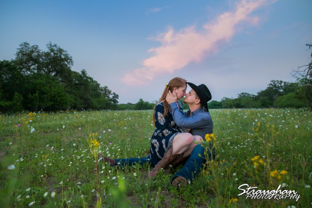 Caleb and Jamie's Engagement Poteet sitting in the field