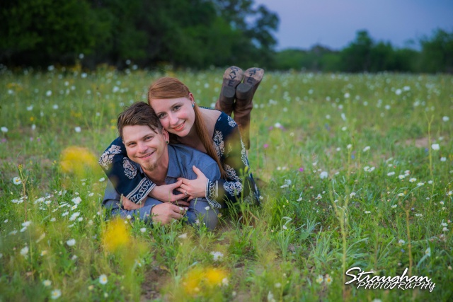 Caleb and Jamie's Engagement Poteet laying down