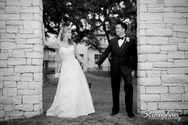 Jessica wedding Hyatt Hill Country Resort the couple black white with the wall