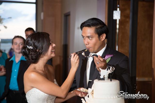 Cristina wedding St. Peters the Apostle Catholic Church Boerne cake feeding