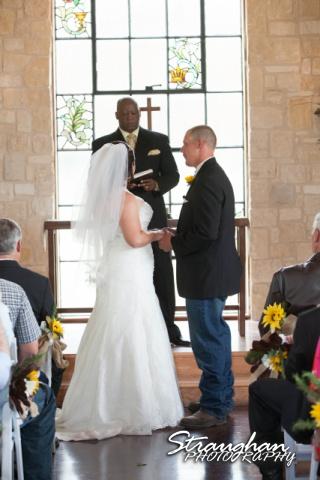 Wedding Faithville Village Devon ceremony olding hands
