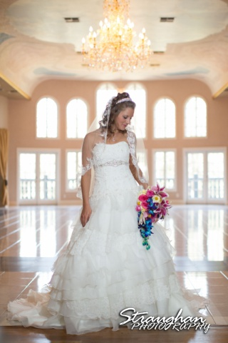 Jazmine Bridal Castle Avalon in the doorway