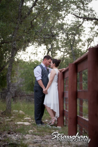 Josh DIY wedding Spring Branch couple on fence