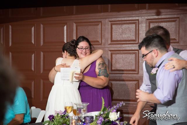 Josh DIY wedding Spring Branch toasts hugging