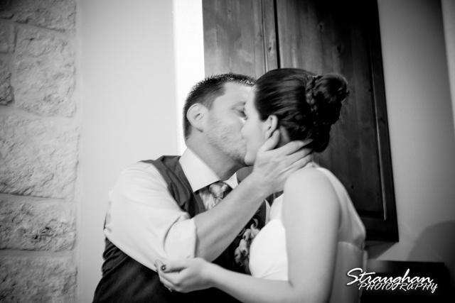 Josh DIY wedding Spring Branch cake cutting kiss