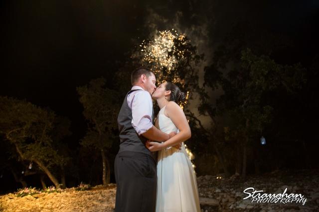 Josh DIY wedding Spring Branch kissing in the fireworks