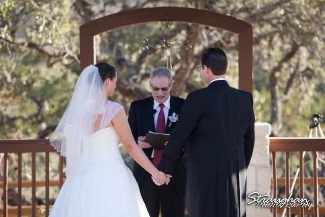 Wedding Bella Springs Jennifer ceremony holding hands