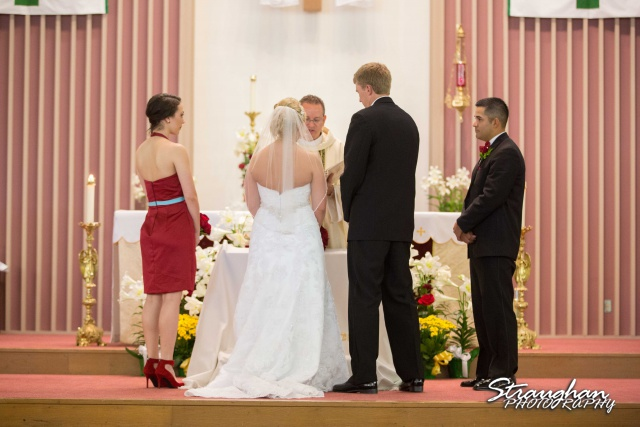 Katie wedding Kendall Plantation couple in the church vows