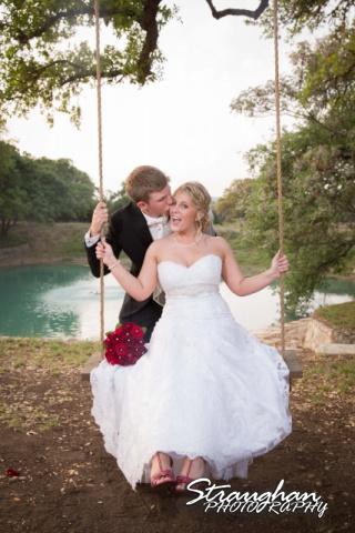 Katie wedding Kendall Plantation bride on swing groom kissing her