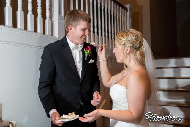 Katie wedding Kendall Plantation cake feeding