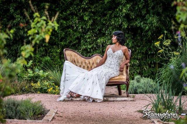 Jennifer Moore's Bridal Sitting at Landa Library laying across a bench