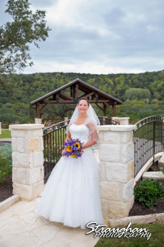 J_Miller bridal at Bella Springs standing on the bridge