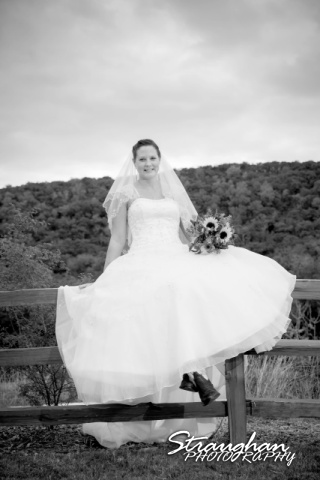 J_Miller bridal at Bella Springs sitting on the fence black white