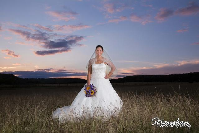 J_Miller bridal at Bella Springs at sunset in the fiel landscape