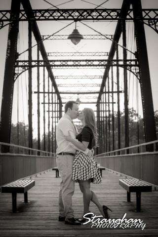Joanna's Engagement kissing on bridge bw