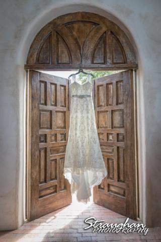 Jackie and Steve's wedding dress in doorway