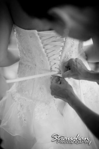 Jazmine's wedding Travis park church tying the dress