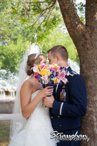 Jazmine's wedding McNay couple behind flowers