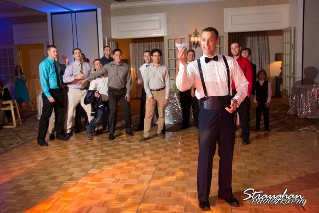Jazmine's wedding Omni de la Mansion garter toss