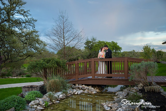Katie and Alex Wedding the Springs New Braunfels on the bridge