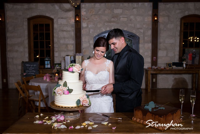 Katie and Alex Wedding the Springs New Braunfels cake cutting