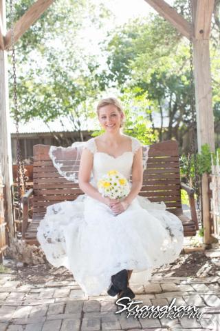 Katie bridal Gruene sitting on the swing