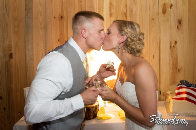 Katie wedding reception Boulder Springs cake kiss
