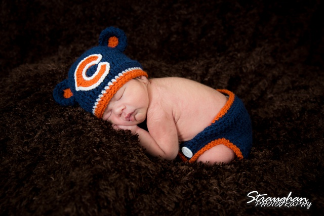 Baby Keagan in Bears costume suggling