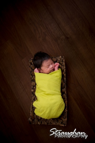 Baby Keagan in green on floor