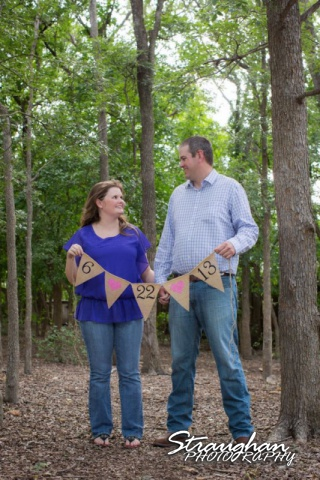 Kelly engagement Gruene forrest with banner