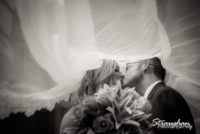Kelley wedding St Peter's Boerne kissing under veil